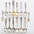 Sterling silver souvenir spoons group of fourteen earlymid 20th c nebraska colorado and spokane wa all marked longest 6 9 ot