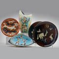 Adolf dehn etc stonelain four pieces by adolf dehn vase with eve pair of chargers with horses and plate with cubist dancers together with cats and dogs charger marked prats usa 1950s all w