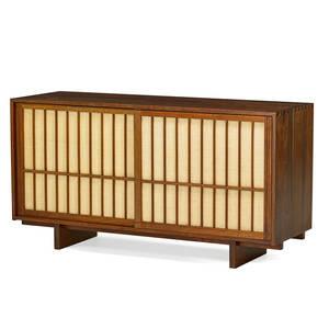george nakashima 1905  1990 nakashima studios sliding door cabinet new hope pa before 1958 walnut pandanus cloth unmarked 31 12 x 60 x 20 provenance available letter of authen