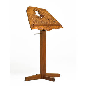 george nakashima 1905  1990 nakashima studios adjustable music stand new hope pa 1980 walnut carpathian elm burl unmarked as shown 45 x 24 x 24 provenance available copy of origi