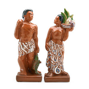 Thelma frazier winter 1908  1977 glazed ceramic figures of a polynesian fisherman and woman ohio 1930s both signed thelma taller 14 x 4 12