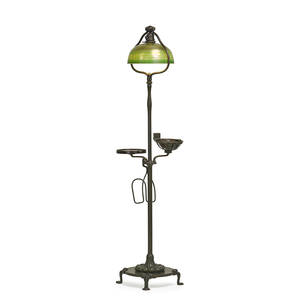 Tiffany studios rare floor lamp with smoking stand and book rack etruscan favrile glass shade new york 1900s patinated bronze favrile glass mahogany single socket shade etched lct favril