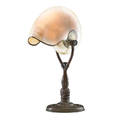 Tiffany studios nautilus table lamp with dolphins base new york 1900s patinated bronze nautilus shell silvered metal single socket base stamped tiffany studios new york 634 14 12 x 9 x