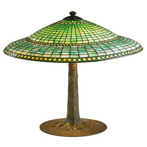 Suess fine table lamp geometric shade on tree trunk base chicago 1900s patinated metal leaded slag glass four sockets unmarked overall 24 x 30 literature suess catalog 1906 no 420