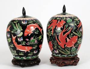 PAIR OF FAMILLE NOIR PORCELAIN JARS AND COVERS