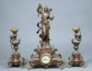 THREE PIECE PATINATED METAL AND MARBLE CLOCK GARNITURE