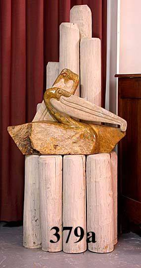 379A Carved Stone Pelicans on a Driftwood Style Base