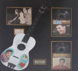 ELVIS PRESLEY SIGNED CUT SHEET AND 1956 TOY GUITAR DISPLAY