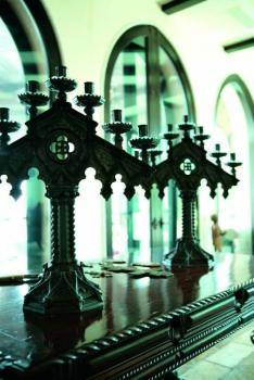 A PAIR OF GOTHIC STYLE CANDLEABRA