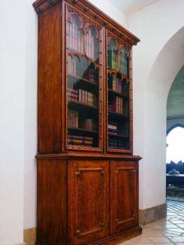 Victorian Gothic Revival oak bookcase cabinet