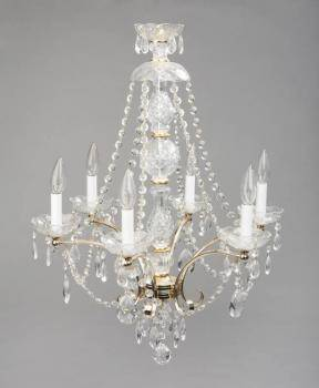 EVANDER HOLYFIELD CRYSTAL AND BRASS SIX LIGHT CHANDELIER