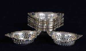 104 SET OF FOURTEEN STERLING SILVER NUT DISHES