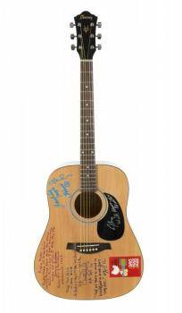 WOODSTOCK PERFORMERS SIGNED AND INSCRIBED GUITAR