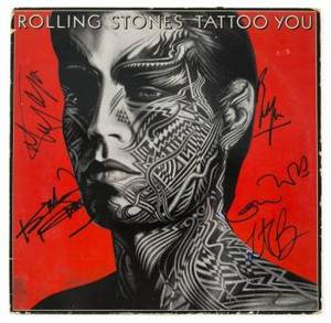 ROLLING STONES SIGNED TATTOO YOU ALBUM COVER