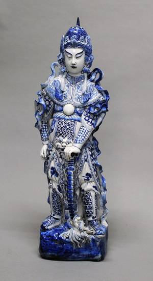141 BLUE AND WHITE PORCELAIN FIGURE OF AN IMMORTAL