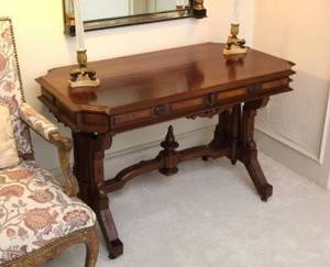 AMERICAN VICTORIAN LIBRARY TABLE ON CASTORS