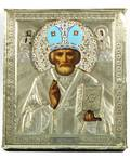 A RUSSIAN ICON OF SAINT NICHOLAS THE MIRACLEWORKER IN A GILTSILVER OKLAD 19081926