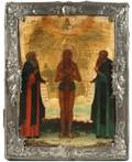 A RUSSIAN ICON OF SAINTS ZOSIM AND SAVATIY SOLOVETSKIE WITH SAINT IN SILVER BORDER OKLAD C 1784