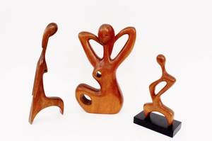 Group of Three Carved Wood Figures Casas