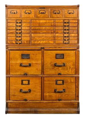 A Victorian Oak Collectors Cabinet Yawmanen and Erbe Manufacturing Rochester New York