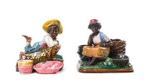 A Pair of Majolica Figural Match Strikers