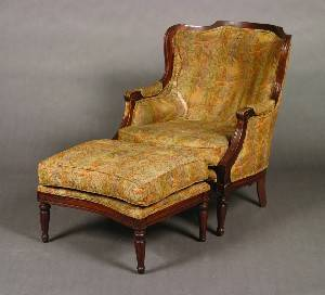 A Louis XVI Style Walnut Bergere and Ottoman