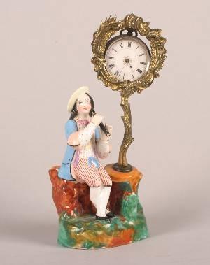 A Porcelain Figural Pocket Watch Holder
