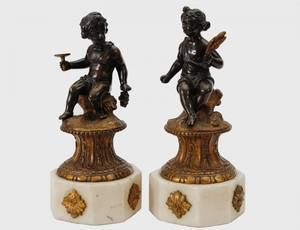 452 PAIR OF PATINATED AND GILT BRONZE PUTTI