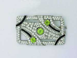 A Ladys Platinum Diamond Black Onyx and Peridot Art Deco Brooch