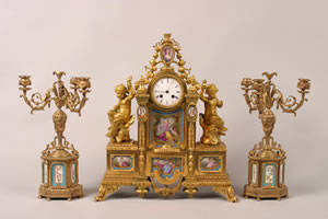 An Eight Day Time and Strike Gilt Bronze Mantel Clock with Candelabra