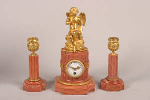 An Eight Day Time Only French Marble Mantel Clock with Two Candlesticks