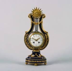 An Eight Day Time and Strike French Sevres Lyre Mantel Clock