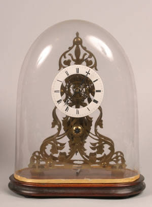 An English Skeleton Clock with Dome on a Wooden Base
