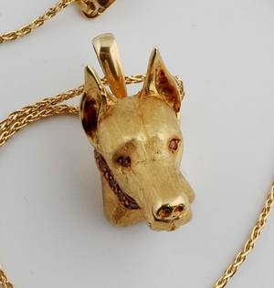 An 18 Karat Yellow Gold and Fancy Color Diamond Pendant