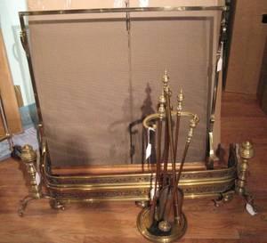 An Assembled Set of Brass Fireplace Accessories