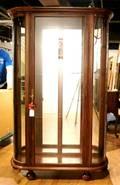 A Demilune Mahogany Curio Cabinet