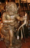 A Molded and Painted Plaster Figure of Cupid