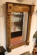 A Neoclassical Style Giltwood Mirror