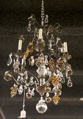 An Iron and Crystal SixLight Chandelier