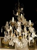 A GiltMetal and Glass EightLight Chandelier