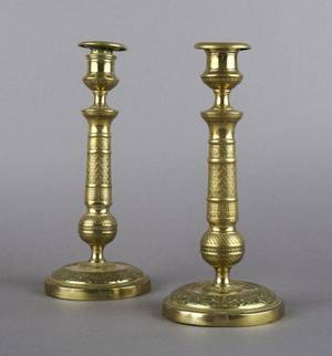 A Pair of Empire Style Brass Candlesticks