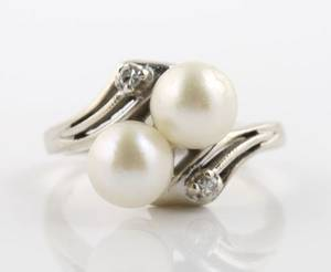A 14 Karat White Gold Cultured Pearl and Diamond Ring