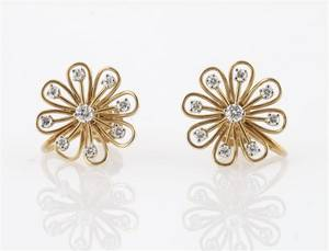 A Pair of 14 Karat Yellow Gold and Diamond Earrings
