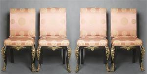 A Set of Four Continental Metal Mounted Side Chairs