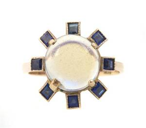 A 14 Karat Yellow Gold Moonstone and Sapphire Ring