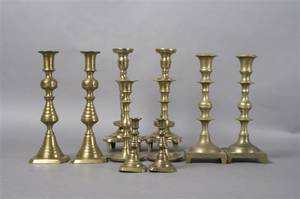 A Group of Five Pairs of Brass Candlesticks