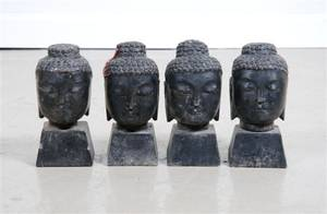 A Group of Four Stone Carvings of Buddha