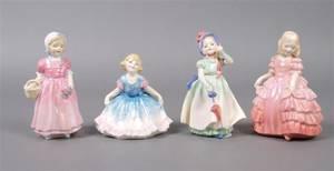 A Group of Royal Doulton Miniature Porcelain Figures