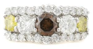 An 18 Karat White Gold Fancy Brown Diamond Yellow Diamond and White Diamond Ring