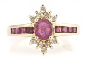 A 14 Karat Yellow Gold Ruby and Diamond Ring
